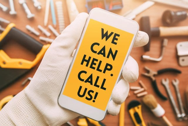 stock-photo-handyman-smart-phone-app-contact-message-on-mole-phone-screen-we-can-help-call-us-1080615965